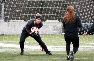 Ilya Pinchuk | Argonaut Junior goalkeeper Caroline Towles makes a save during practice Thursday on the SprinTurf. The Vandals' spring season continues with a double-header home stand against Washington State and Central Washington at 10 a.m. Sunday on the SprinTurf.