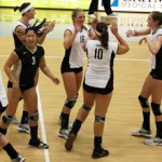 Steven Devine | Argonaut Idaho players celebrate winning a point Thursday evening against Texas State. The Vandals fell to a 2-0 deficit but cinched the ensuing three sets to claim the match.