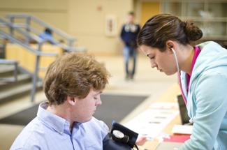 Jesse Hart   Argonaut Allyssa Nilsson checks Vanessa Kaminski's blood pressure in the University of Idaho Commons on Thursday as part of Alpha Phi Sorority's