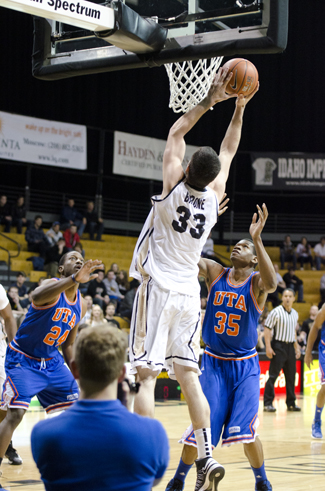 Jesse Hart | Argonaut Vandal center Kyle Barone dunks over UTA's Kevin Butler and Brandon Edwards Thursday in the Cowan Spectrum. Idaho lost its third consecutive game, a 71-68 decision to the Mavericks.