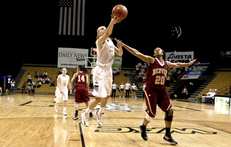 Alyssa Charlston makes her way past a Denver defender for two more Vandal points during their game Saturday in Cowan Spectrum. The Vandals took home a win 70-64 and will travel to Arlington Texas Thursday to face UT Arlington.