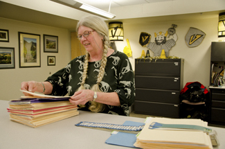 Hayden Crosby | Argonaut Sue Westervelt, employee at the Office of Admissions and Campus Visits, sorts through applications for Fall 2013 Monday in the UI Campus Visits Office located on the first floor of the Student Union Building.