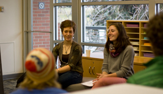 Ricky Scuderi | Argonaut Sustainability Center Projects Coordinator and junior in Environmental Science, Wieteke Holthuijzen, left, along with Environmental Science junior and Volunteer Coordinator Alex Rheault, talk to students about getting involved during the Snacks with Student Leaders event Feb. 14.