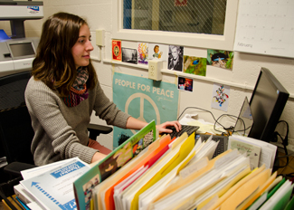 Hayden Crosby   Argonaut Environmental Science senior Alex Rheault works at the Sustainability Center office. She is in the process of joining the Peace Corps, a volunteer program run by the United States government.