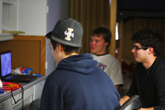 Ricky Scuderi | Argonaut Freshmen Brett Blackstock, left, James May and Keynan Hartz play Call of Duty in their new Ballard dorm room in the Wallace Complex Tuesday. Students are beginning to renew rooms for the upcoming school year.