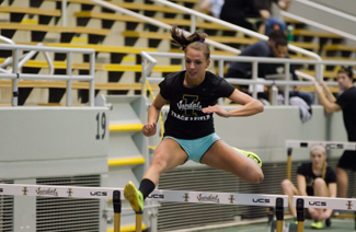 Junior Cait Rowland practices hurdles Thursday in the Kibbie Dome. Rowland has an indoor career best of 8.99 seconds in the 60-meter hurdles and a 14.70 in the outdoor 100-meter hurdles.  Idaho will compete in the Husky Classic Friday through Sunday.