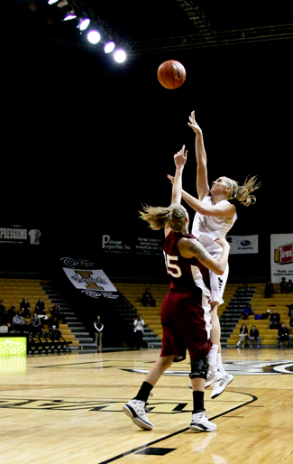 Steven Devine | Argonaut Alyssa Charlston drives past a defender to put up two more Vandal points during Idaho's game against New Mexico State Thursday evening in the Cowan Spectrum. The Vandals will host Denver at 2 p.m. Saturday in the Cowan Spectrum.