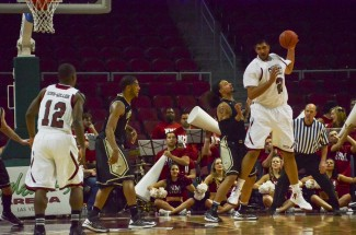 Theo Lawson | Argonaut  New Mexico State's Sim Bhullar sizes up Wendell Faines during the Vandals and Aggies quarterfinal match-up Thursday at the Orleans Arena in Las Vegas. Idaho held the eventual tournament MVP to seven points and seven rebounds but NMSU guard Daniel Mullings erupted for 23 points in the Aggies' 65-49 victory.