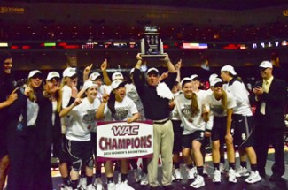 Theo Lawson | Argonaut Coach Jon Newlee hoists the WAC Championship trophy above the heads of his players who won Idaho's first conference championship since 1985.