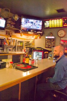 abi stomberg | rawr University of Idaho Law student Pete Thomas takes a break and has a brew at the Corner Club on Monday. The bar was ranked fifth in the nation for best college bars.