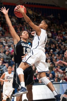 Steve Slade | UConn Athletic Department UConn guard Moriah Jefferson leaps over Idaho freshman Ali Forde during the Vandals' 105-37 loss to UConn. Idaho lost 105-37 Saturday during the first round of the NCAA Tournament, the program's first NCAA appearance since 1985.