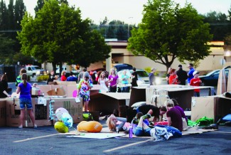 Alycia Rock | Argonaut Participants of the Cardboard Box City fundraiser for Family Promise of the Palouse gather in boxes in the Eastside Marketplace parking lot. The event raised money for Family Promise of the Palouse, as well as awareness of homelessness in the area.