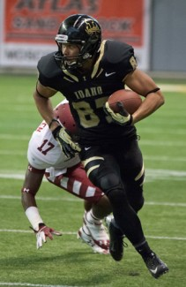 Tony Marcolina   Argonaut Wide receiver Roman Runner evades a tackle during Saturday's Homecoming game against Temple at the Kibbie Dome. The Vandals won their first game of the season 26-24.