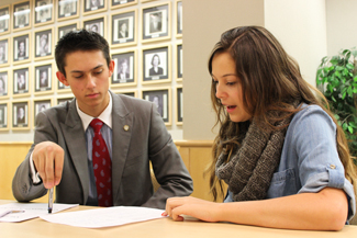 George Wood | Argonaut Elections Coordinators Tanner Beymer, left, and Pilar Alfaro review the election guidelines Wednesday at the ASUI meeting in the Whitewater Room at the Idaho Commmons.