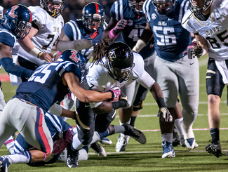 Courtesy Photo by Ilya Pinchuk | University of Idaho Running back James Baker gets tackled by Cody Prewitt during Saturday's game against Ole Miss at Vaught-Hemingway Stadium in Oxford, Miss. The Vandals fell to the Rebels 59-14. Baker had 58 total yards on Idaho's first scoring drive.