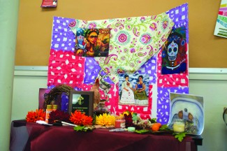 abi stomberg | rawr An example of the Dia de los Muertos alter stands tall in Administration building room 318. Students are invited to create their own for the competition at the end of the month.
