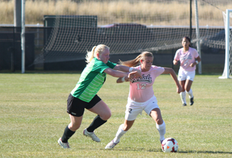 File photo by Curtis Ginnetti | Argonaut Alyssa Pease fends off a defender while moving the ball down the pitch during an Oct. 20 game against Utah Valley. Pease scored the only goal of the game in a 1-0 Idaho win at NMSU on Sunday.