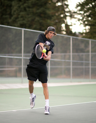 Phil Vukelich | Argonaut Andrew Zedde, sophomore, returns service during a practice match Monday at the Memorial Gym tennis courts. The tennis team competes Wednesday to Sunday at the ITA Regional Championships in Las Vegas.