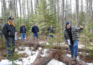 Randy Brooks | Courtesy Extension Forestry Specialist Randy Brooks (right) discusses logging opportunities in areas with lodge-pole pines killed by pine beetles with a group of Idaho loggers. A $10 million research grant provided by the USDA is funding the project.