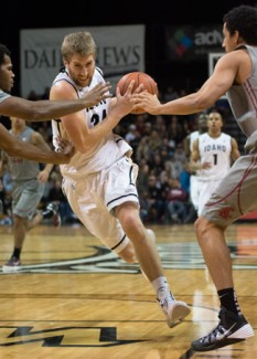 File Photo by Tony Marcolina   Argonaut Idaho forward Stephen Madison drives past defenders during the Dec. 7 game against Washington State in the Cowan Spectrum. The Vandals lost Wednesday at Montana 69-58.