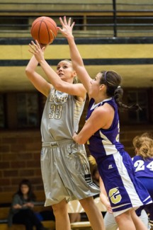 File photo by Tony Marcolina | Argonaut Alyssa Charlston shoots over her defender during the Dec. 3 game against Carroll College at Memorial Gym. The Vandals lost 59-56 against Montana and won 83-60 against Appalachian State over the weekend in the 33rd Lady Griz Classic at Missoula, Mont.