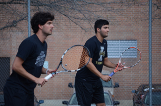 Nathan Romans | Argonaut Doubles partners Jose Bendeck and Cristobal Ramos Salazar wait for a return volley during practice Saturday. The men's tennis team will face the No. 1 overall seed USC Trojans in Los Angeles Saturday, May 10.