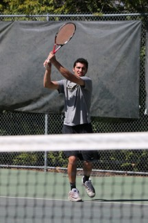 Parker Wilson | Argonaut Assistant coach Abid Akbar practices with the women's tennis team at the Memorial Gym tennis courts in preparation for its NCAA tournament match on Friday.