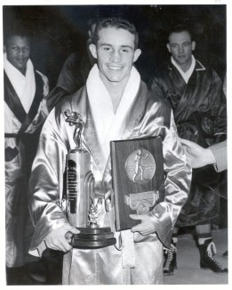 Frank Echevarria holds his national championship trophy and the LaRowe Trophy, which was given annually to the nation's best boxer. Echevarria now lives in Blackfoot, Idaho. Courtesy | UI