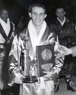 Echevarria with his national championship trophy and the LaRowe Trophy, which was given annually to the nation's best boxer. Photo courtesy | UI library special collections