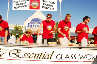Contestants at the 2nd Annual New York Johnny's Pacific Northwest Hot Dog Eating Contest scarf down hot dogs in August 2012. Recently New York Johnny's stand has been absent from Main Street  in Moscow, due to owner Johnny Saltarella's hiatus from the business.