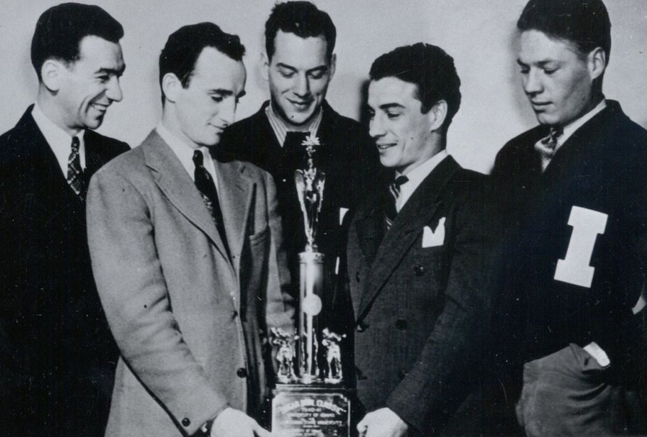Coach Louie August, Ted Kara, Chase Anderson, Frank Kara and Laune Erickson hold the Sugar Bowl trophy in 1941. What was originally a club sport created by August, Idaho won 19 national championships, before the sport was discontinued in 1954.