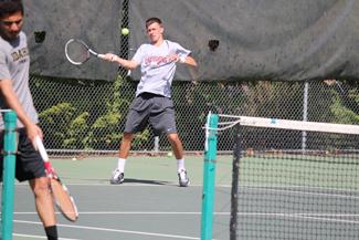 Parker Wilson | Argonaut Idaho senior Artemy Nikitin returns a hit by his partner during tennis practice Thursday afternoon the Memorial gym tennis courts.