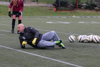 Parker Wilson | Argonaut New Idaho soccer coach Derek Pittman works with his goalies during a spring practice.