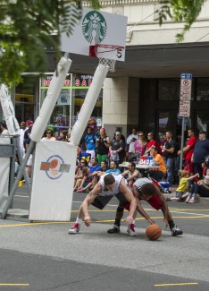 Players scramble for the ball at the 25th annual Hoopfest in downtown Spokane.