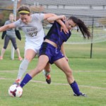 Junior forward Reagan Quigley jumps  past a Weber State defender during Idaho's 3-2 double overtime loss Friday at Guy Wicks Field. Quigley scored her first career goal to tie up the game in the 76th minute.