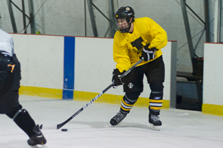 Nathan romans | Argonaut Forward Ian Nicoll looks to pass as he moves down the ice during Wednesday's prac- tice at the Palouse Ice Rink. The Idaho men's hockey club will play Washington State at 7 p.m. Saturday at the Palouse Ice Rink in Moscow.