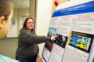 Nathan Romans   Argonaut Senior Sarah Gussenhoven, a geology and secondary education major, talks about her poster on the effects of acidification on the ocean Tuesday in the Idaho Commons.