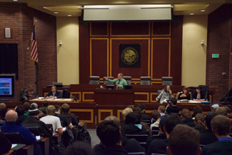 Brenda Ely | Argonaut UI students, staff and faculty gather in the College of Law Menard Building Courtroom Nov. 19 to hear a discussion on the proposed tobacco ban.