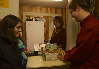 Jackson Flynn | Argonaut Seniors Marissa Bourbonnais (left) and Tyler Folts (right) donate to the Moscow Food Bank Wednesday. It is located on 110 N. Polk St. adjacent to St. Mary's Catholic Church. The Palouse Cares Food Drive will take place on Saturday.