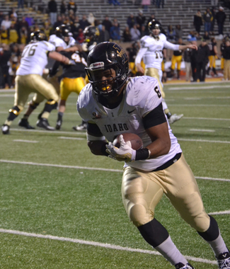Junior running back Elijhaa Penny runs the ball in Idaho's 45-28 loss Saturday at Appalachian State. The loss brought Idaho's season record to 1-10. Penny led the Vandals with 95 rushing yards, two rushing touchdowns and one receiving touchdown.