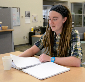 Amelia C. Warden | Argonaut Senior Clare Haley, 22, discusses her major while studying at the ASUI office Wednesday. Haley is a senior graduating with a degree in international studies and plans to travel in the coming months.