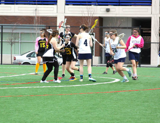 Idaho women's club lacrosse | Courtesy The Idaho women's club lacrosse team sets up its defense against Whitman during the 2014 Boise Classic in the spring. Brittiany Graham, third from the left will coach the Vandals in 2015 after graduating this fall.