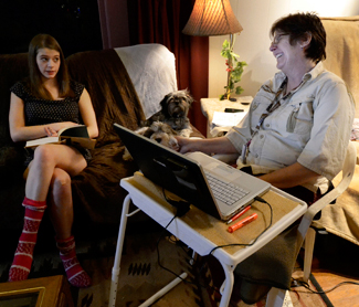 Amelia C. Warden | Argonaut Lisa Cochran (right) talks with her daughter Madysen (left), 16, about an independent project she is working on for a class at Moscow High School in the living room of their home in Moscow, Tuesday. Cochran said her low wages have caused financial stress.