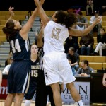 Ali Forde reaches for the opening tip during Thursday's game against Montana State in the Cowan Spectrum.