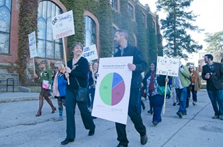 Nathan Romans | Argonaut UI adjunct faculty march in front of the Administration Building Wednesday to observe National Adjunct Walkout Day. Protestors sought to raise awareness of contingent faculty working conditions.