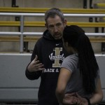 Idaho coach Tim Cawley directs sprinter Andrea Pikes Jan. 15 in the Kibbie Dome. The Vandals competed at the Cougar Indoor Friday and Saturday in Pullman.
