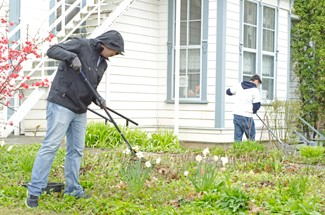 """Nathan Romans   Argonaut Senior PR major Allen Jennings, left, rakes leaves in front of the McConnell Mansion Saturday during """"Saturday of Service,"""" which is sponsored by the Center for Volunteerism and Social Action."""