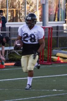 Kira Hunter | Argonaut Freshman running back Isaiah Saunders runs down the sideline at Friday's practice on the SprinTurf.