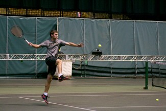 Idaho junior Odon Barta jumps to return the ball at practice Feb. 18 in the Kibbie Dome.