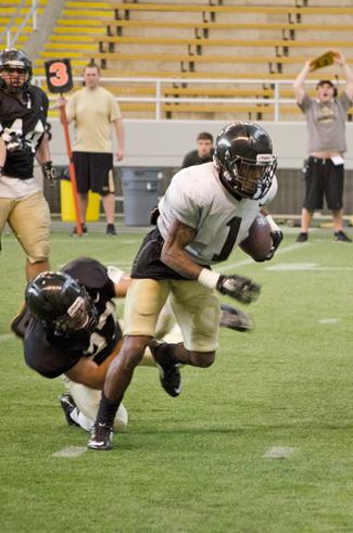 Nathan Romans | Argonaut Senior wide receiver Dezmon Epps shakes off a defender during Idaho's scrimmage Staurday in the Kibbie Dome.